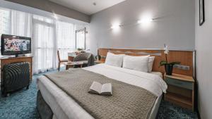 Letto o letti in una camera di City Park Hotel Sochi