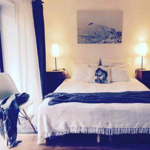 Łóżko lub łóżka w pokoju w obiekcie Willa Iga