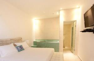 A bed or beds in a room at Allure Suites