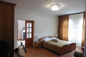 Кровать или кровати в номере Гостевой Дом Яна