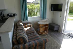 Ein Sitzbereich in der Unterkunft Ferienhaus Silbermöwe