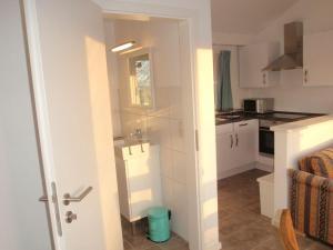 Küche/Küchenzeile in der Unterkunft Ferienhaus Silbermöwe