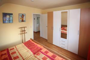Ein Bett oder Betten in einem Zimmer der Unterkunft Elzachferien