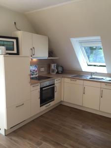 Küche/Küchenzeile in der Unterkunft Huus Windroos  Wohnung 2