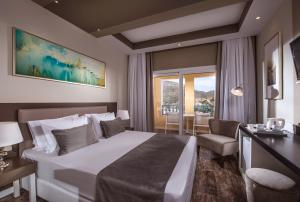 A bed or beds in a room at Fodele Beach Water Park Resort
