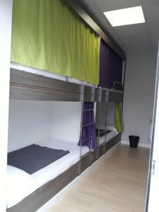 A bunk bed or bunk beds in a room at Albergue Camiño Do Sar