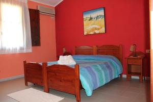 A bed or beds in a room at Ostello Su Mannau