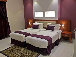 Cama ou camas em um quarto em Beautiful Moment Furnished Apartments