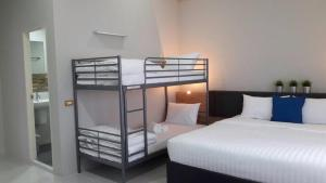 A bunk bed or bunk beds in a room at Addera Residence Hua Hin