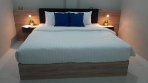 A bed or beds in a room at Addera Residence Hua Hin