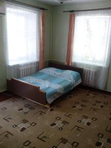 Кровать или кровати в номере Apartment on Lenina 61