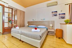 A bed or beds in a room at Villa Diasselo