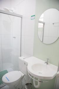 Um banheiro em Hotel Turiassú