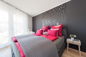 Ein Bett oder Betten in einem Zimmer der Unterkunft V7 Boutique Appartements