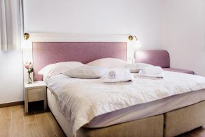 Postel nebo postele na pokoji v ubytování Villa Palloma