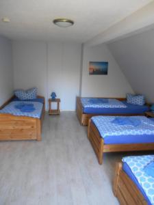 Ein Bett oder Betten in einem Zimmer der Unterkunft Pension Gut Grabitz