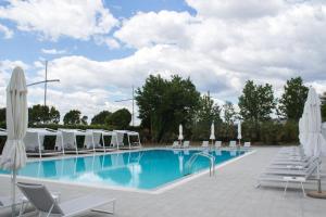 The swimming pool at or near Makedonia Palace