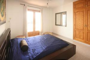 A bed or beds in a room at Hostal Santa Eulalia