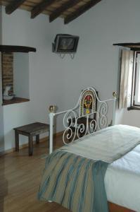 A bed or beds in a room at Quinta Do Vaqueirinho - Agro-Turismo