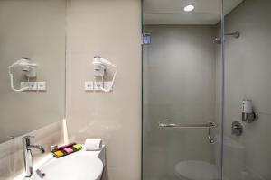 A bathroom at ibis Styles Cikarang