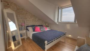 A bed or beds in a room at Villa Mediterranea - Rooftop Suite
