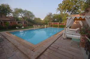 The swimming pool at or close to Devi Bhawan - A Heritage Hotel
