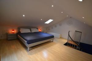 A bed or beds in a room at Maisonnette