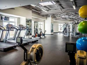 The fitness center and/or fitness facilities at Nova Suites Inc.