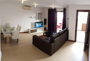Zona de estar de Comfy duplex in Puerto Calero