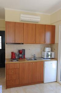 A kitchen or kitchenette at Calypso Luxury Studios