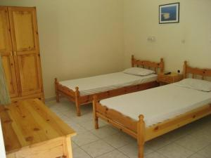 A bed or beds in a room at Mediterraneo studios