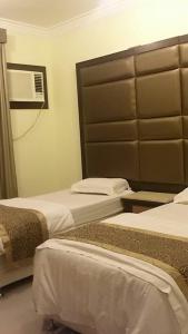 Cama ou camas em um quarto em Rahati ApartHotel