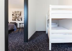 Een stapelbed of stapelbedden in een kamer bij FourSide Trier