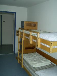 A bunk bed or bunk beds in a room at Jugendherberge Karlsruhe