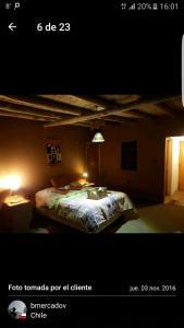 Una cama o camas en una habitación de Hotel Pukarainca