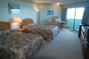 Кровать или кровати в номере North Shore Inn