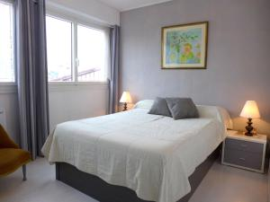 A bed or beds in a room at Apartment Victor Hugo