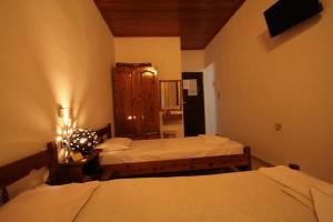 Ένα ή περισσότερα κρεβάτια σε δωμάτιο στο Chania Rooms