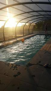 The swimming pool at or near Les Chambres de Ribeaufontaine