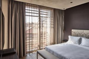 Cama ou camas em um quarto em Hotel VIU Milan