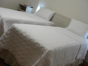 A bed or beds in a room at Colatina Plaza Hotel