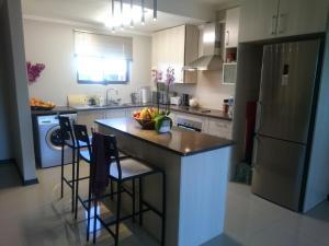 A kitchen or kitchenette at Lifestyle@Village