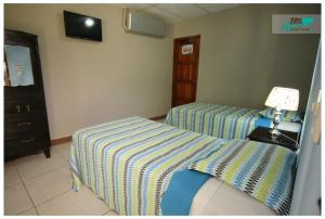 A bed or beds in a room at Hotel Casa De Angeles