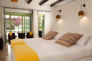 A bed or beds in a room at Hotelito La Era B&B