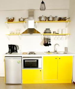 A kitchen or kitchenette at Crops Suites