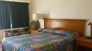 A bed or beds in a room at Nites Inn Motel