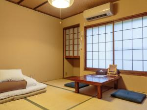 A seating area at Gion Ryokan Q-beh