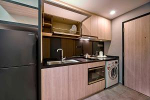 A kitchen or kitchenette at Orchard Grand Court