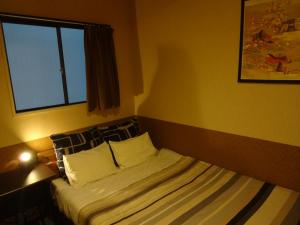 A bed or beds in a room at Khaosan Kyoto Guesthouse