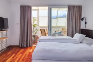 Ein Bett oder Betten in einem Zimmer der Unterkunft Hotel Central